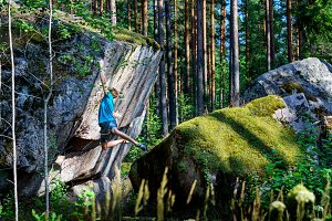 Male climber climbing overhanging ro