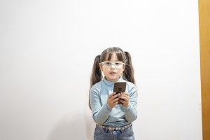 Little girl looking at smart phone s