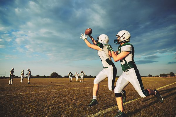 Stock Photos: Stefan & Janni - Young American football player makin