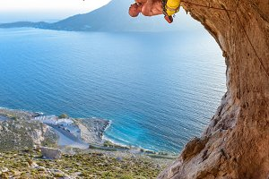 Rock Climber on a picturesque rock a