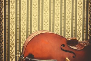 Vintage contrabass on wooden floor.