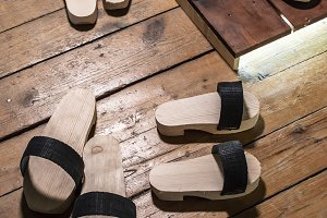Vintage wooden slippers with straps.