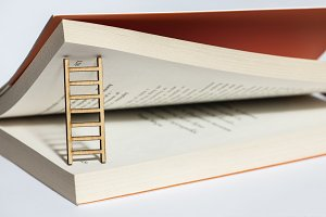 Book pages and ladder. Concept with