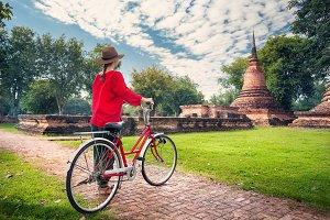 Woman with bicycle near Buddhist rui