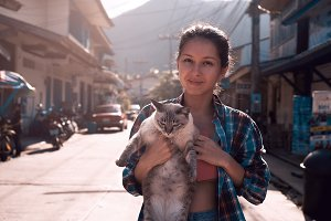 cute young woman with cat outdoors