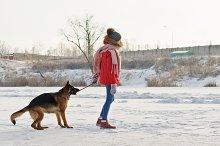 Teenager girl and German shepherd.