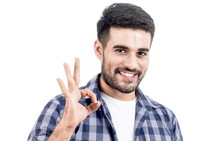 Young man makes gesture OK isolated