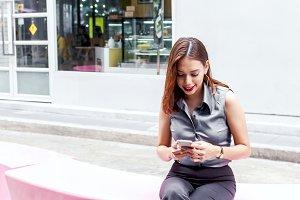 ํYoung woman using smartphone