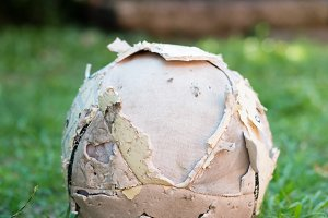 Used soccer ball on the grass
