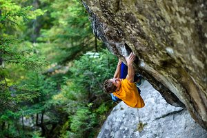 Strong climber on a challenging boul