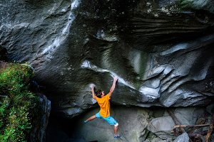 Rock climbing, bouldering. Male athl