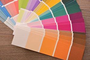 Colour palette in fan on wood table
