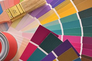 Brush and paint pot on colour chart