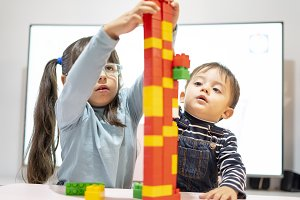 Children play making towers with pla