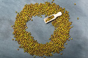 Dry green mung beans over the slate
