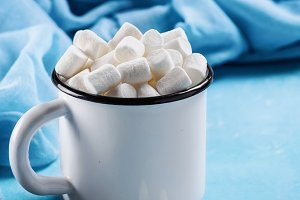 Marshmallows on blue background with