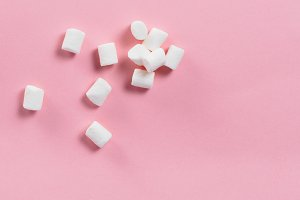 Marshmallows on pink background with