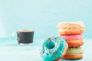 donuts and coffee on blue background