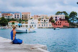 Woman tourist sitting on the pier