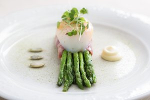 Green asparagus with poached egg on