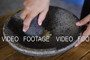garlic crushed in stone mortar