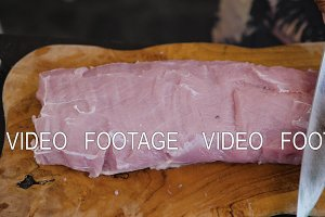 knife hand cuts meat