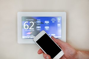 Smart phone heating or cooling home
