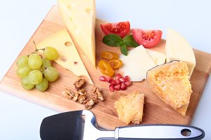 Assortment of cheese with fruits