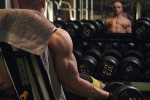one muscular man, bodybuilder arm ex