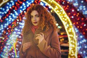 Girl. Festive lights