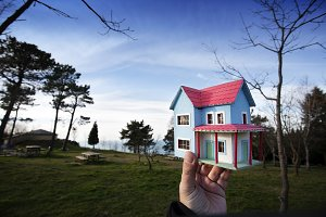 Toy house in the hand
