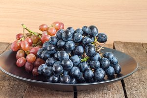 Grapes in black plate