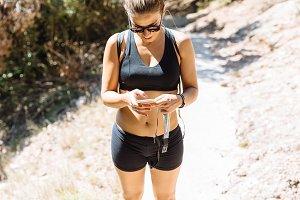 Female athlete checking her phone