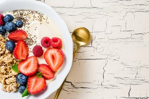 Breakfast with granola and berries