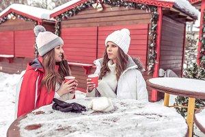 Two girlfriends in the winter in
