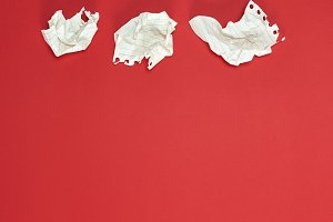 three crumpled white pieces of paper