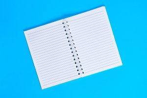 notebook with empty white sheets