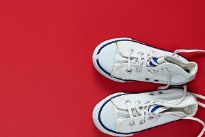pair of white old textile sneakers