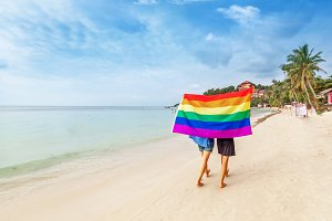 Female couple with lgbt flag