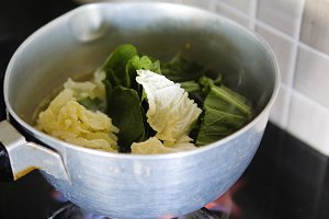 vegetables are cooked in a pan