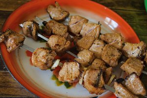 meat on a skewer on a plate
