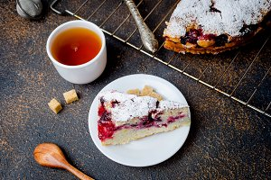 fruit pie and tea on a wooden table