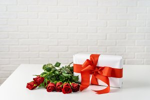 Gift box with bunch of roses on whit