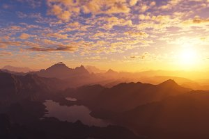 Dramatic burning sunset at mountains