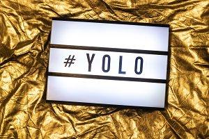Text YOLO on white illuminated board