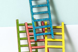Multicoloured ladders on wall. Paste
