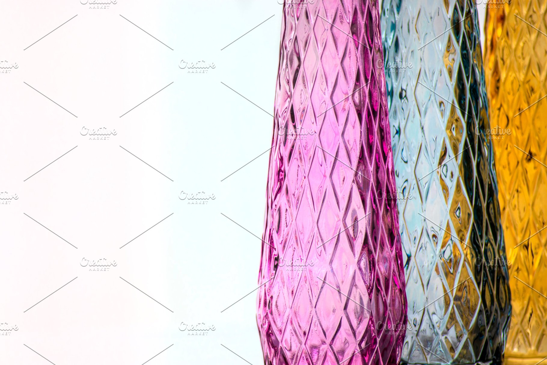 Three Vases Of Colored Glass