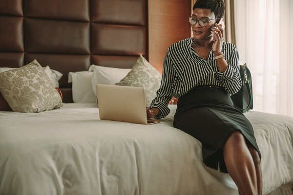 Woman CEO working in hotel room
