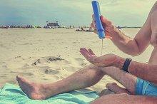 Applying suntan lotion