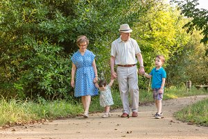 Grandparents and children walking